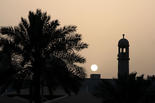 Send picture of Minaret and setting sun in Doha from Qatar as a free postcard
