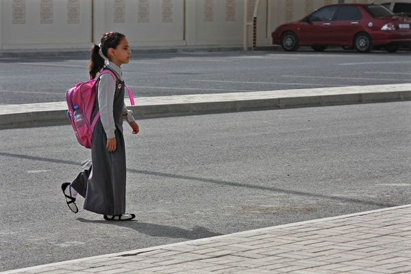 Send picture of Girl walking to school in Al Khor from Qatar as a free postcard