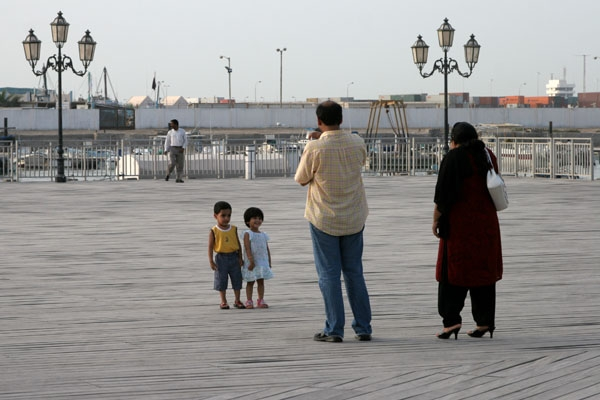Send picture of Family out for a stroll in Doha from Qatar as a free postcard