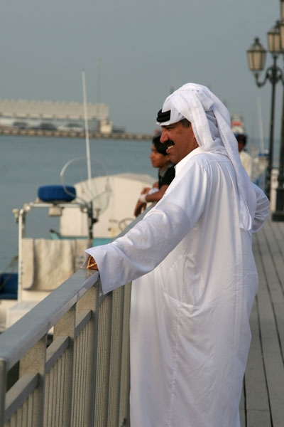 Send picture of Men by the corniche in Doha from Qatar as a free postcard