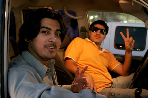 Send picture of Young men in a car in Doha from Qatar as a free postcard