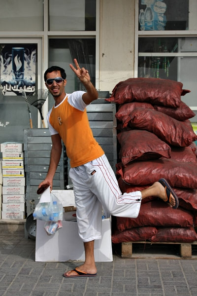 Send picture of Man at a shop in southern Qatar from Qatar as a free postcard