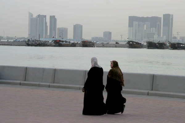 Send picture of Women walking and Doha skyline from Qatar as a free postcard