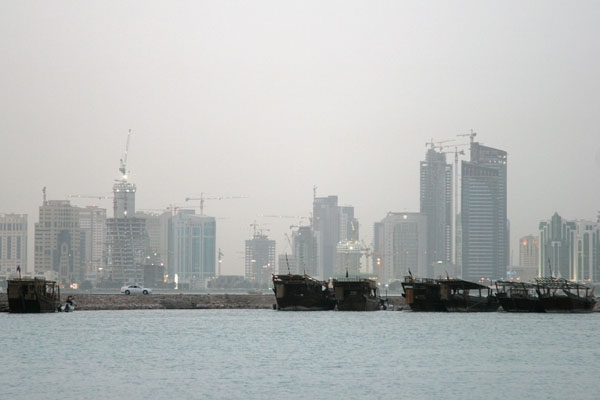 Send picture of Boats in front of the Doha skyline from Qatar as a free postcard