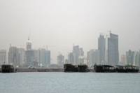 Foto van Boats in front of the Doha skyline - Qatar