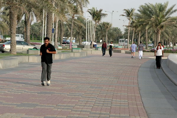 Send picture of Man running on the corniche from Qatar as a free postcard
