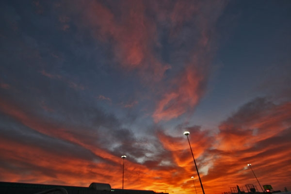 Send picture of Fiery sunrise at Bucharest airport from Romania as a free postcard