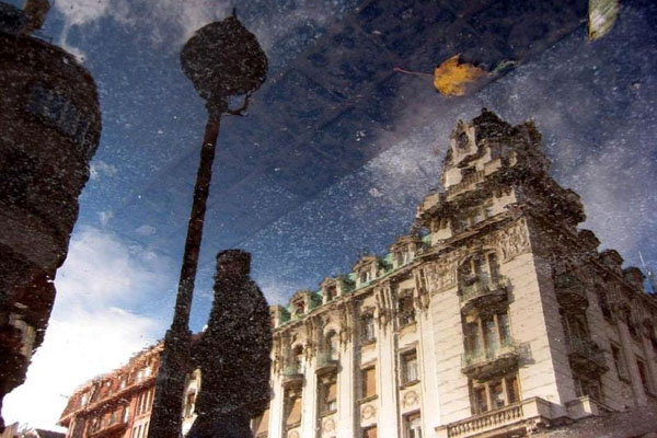 Send picture of Reflection of house in Kneza Mihaila street, Belgrade from Serbia as a free postcard