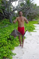Foto di Fisherman with freshly caught rays - Seychelles