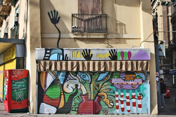 Send picture of Colorful shop facade in Barcelona from Spain as a free postcard