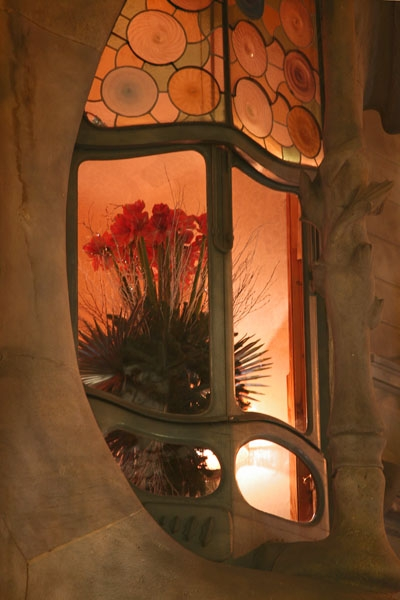 Send picture of Lit window in a Gaudi house in Barcelona from Spain as a free postcard