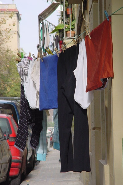 Send picture of Clothes hanging to dry in the streets of Barcelona from Spain as a free postcard