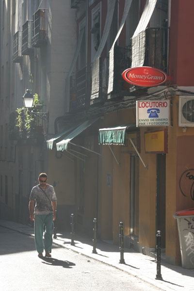 Send picture of Man walking in a Madrid street from Spain as a free postcard