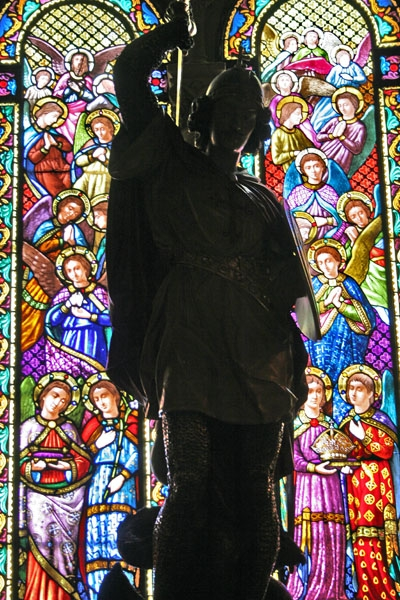 Send picture of Silhouette of statue in the chapel near sacred Moreneta statue in Montserrat from Spain as a free postcard