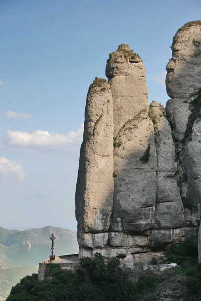 Send picture of Santa Cova chapel by the vertical cliffs of Montserrat from Spain as a free postcard