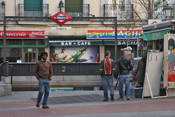 Send picture of People outside Chueca subway station from Spain as a free postcard