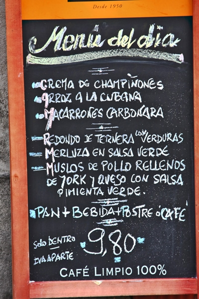 Send picture of Spanish dishes listed on a restaurant menu from Spain as a free postcard