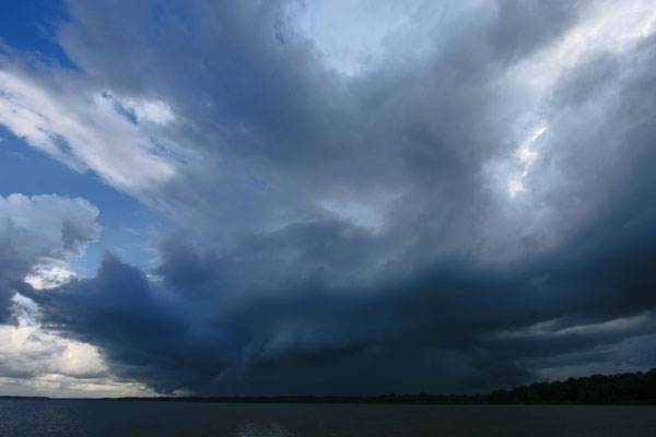 Send picture of A threatening sky in Surinam from Surinam as a free postcard