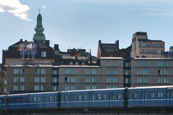 Train passing buildings in Stockholm