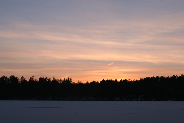 Send picture of Winter sunset from Sweden as a free postcard