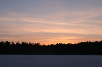 Foto van Winter sunset - Sweden