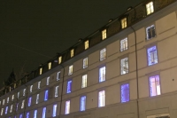 Foto van Iluminated windows in a Geneva building - Switzerland