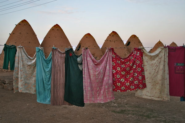 Laundry hanging to dry outside beehive houses in Sarouj