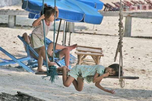 Send picture of Children relaxing on the beach on Koh Samet from Thailand as a free postcard