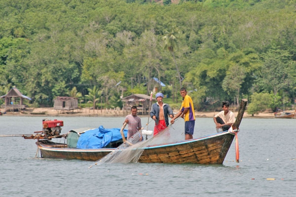 Send picture of Fishermen working close to Koh Mook from Thailand as a free postcard