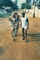 Picture of Brothers and sisters posing on a bike in Lomé, the capital of Togo - Togo
