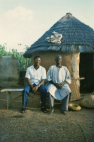 Photo de Man posing with his father in his native village in northern Togo - Togo
