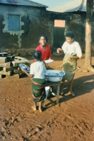 Picture of Girls doing the dishes in front of a Togo house - Togo