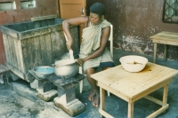 Picture of Woman cooking in her outdoor kitchen - Togo