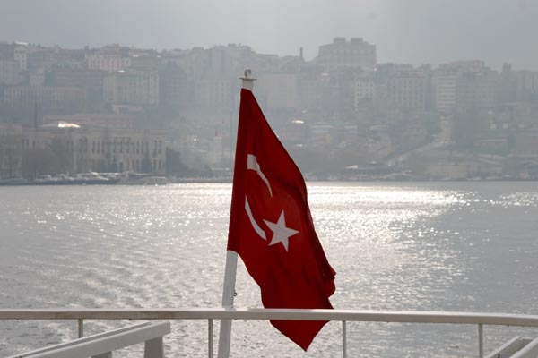 Send picture of A boat sailing up the Golden Horn from Turkey as a free postcard