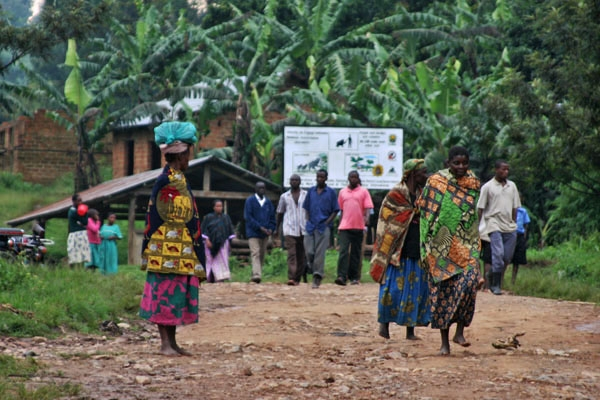 Send picture of People returning from the market in a Ugandan village from Uganda as a free postcard