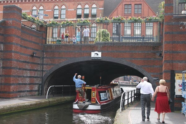 Send picture of Canal boat in Birmingham from United Kingdom as a free postcard