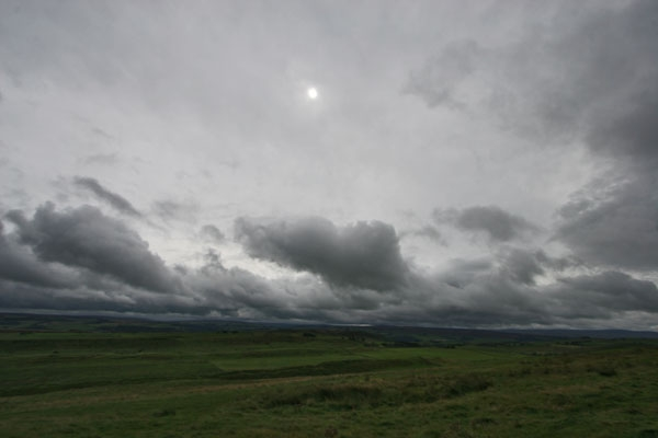 Send picture of Clouds over fields in the countryside of Northumberland from United Kingdom as a free postcard