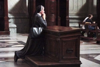 Picture of Nun praying in St. Peter's cathedral in Vatican City - Vatican City