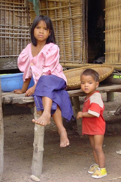 Send picture of Girl and boy at their home in Central Highlands from Vietnam as a free postcard
