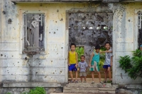 Foto de Boys in wartorn house in Central Highlands - Vietnam