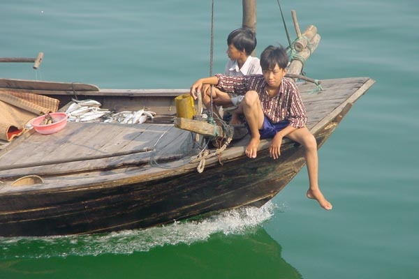 Send picture of Boys on a boat in Halong Bay from Vietnam as a free postcard