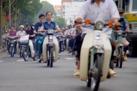 Photo de People riding scooters in Saigon - Vietnam