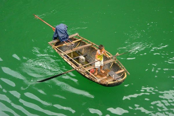  Boy on a boat in Halong Bay