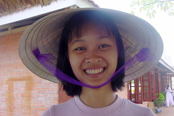 Send picture of A Vietnamese tour guide in northern Vietnam from Vietnam as a free postcard