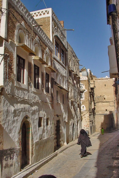 Send picture of Woman walking in a Sanaa street from Yemen as a free postcard