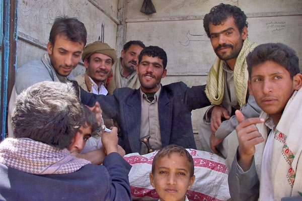 Send picture of Men gathering to chew qat  from Yemen as a free postcard