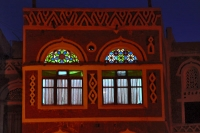 Foto van When lit up at night the Yemeni windows show all of their beauty - Yemen