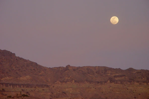 Send picture of Near full moon in a clear sky over San'a from Yemen as a free postcard