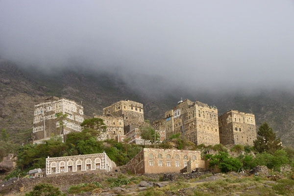 Send picture of Village in the Haraz mountains under heavy clouds from Yemen as a free postcard