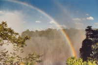 Foto van Rainbows over Victoria Falls - Zimbabwe